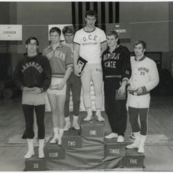 Wrestling Winners Standing on Winners Pedastal