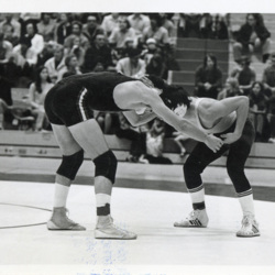 Two Wrestlers Head to Head on Mat